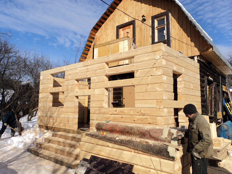 Фото: пристройка к дому из бруса
