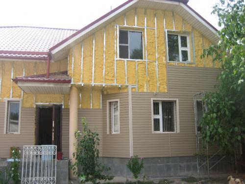 фото: утепление деревянного дома под сайдинг